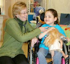 nurse checks heartbeat of child with developmental disability