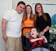 Dylan with, from left, his father Cliff, mother Noreen and speech-language pathologist Jaclynne Dietrich.